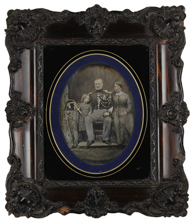 Portrait of three people: child, man and woman