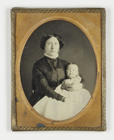 Portrait of  a woman with baby