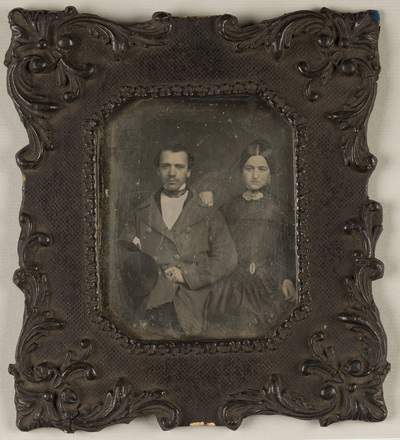 Portrait of a young couple, seated.