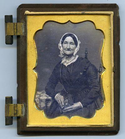 Portrait of elderly woman holding object of pearl