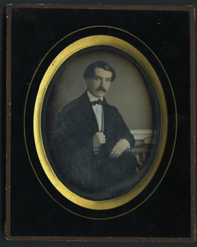 Portrait of young man with bow tie