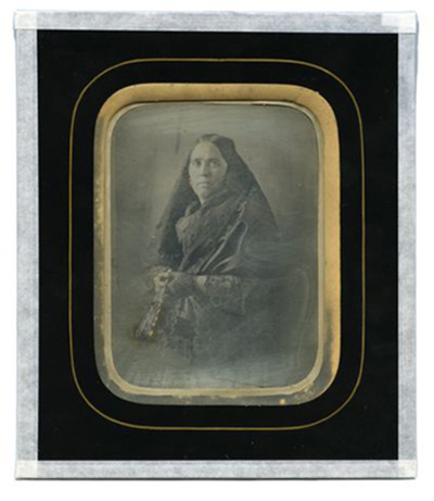 Portrait of woman with handkerchief and fan
