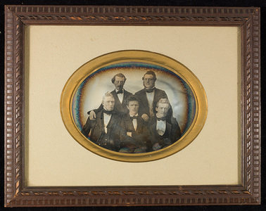 Group portrait of five men.