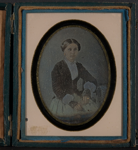 Portrait of young woman with black lace fingerless gloves