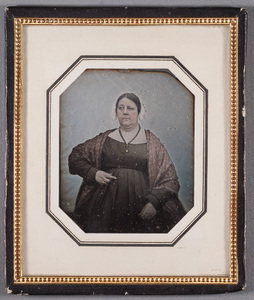 Portrait of an older unknown woman wearing a cross, tinted.