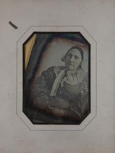 Portrait of old woman wearing a white bonnet
