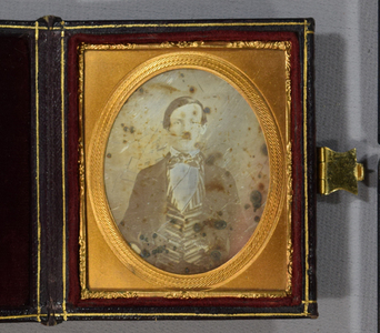 Cased daguerrotype of a man facing forward in a striped waistcoat / Eichmeyer case