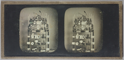 Stereo view of a trade display of scientific equipment by A.Gaudin, Paris. It consists of an assemblage of scientific equipment and six stereo views on a decorative turned wood, six shelf unit.