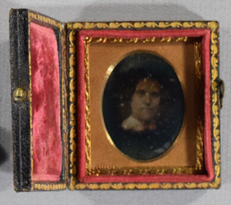 Portrait of a fairly young woman, head and neck / Purchased in Paris 2014 with an albumen print portrait photograph in front of the daguerrotype.