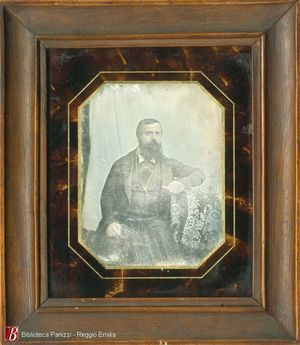 Plate is damaged by scratches and fog in the middle part of the plate. Image maybe  made by a itinerant daguerreotypist because of the draped sheet used as background. Collection Andrea Mandarino. Circular polishing lines.