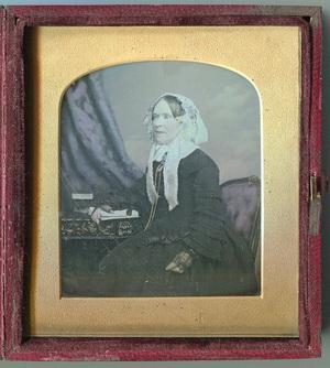 Beautifully tinted portrait of matron.