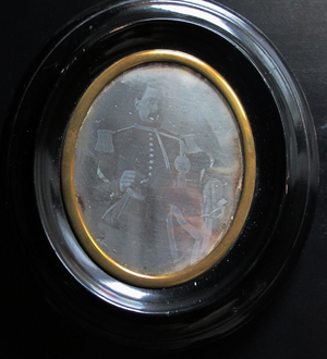 Three quarter length portrait of man wearing a military uniform. Image is hardly visible.