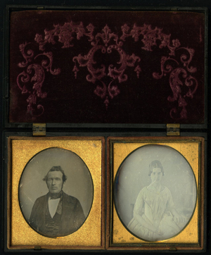 Union case described by Paul K. Berg in Nineteenth Century Photographic Cases and Wall Frames, 2003, p. 70, n. 1-14 recto: Mother embracing child and verso:Geometric. Plates are mounted in oval metal mats, the one for the lady portrait is larger than the other.