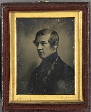 Portrait of an unknown man.  The daguerreotype is mounted in a gilded frame. The name of the creator is attached to the frame. The box is covered with red brown leather. The interior of the case is covered with dark red velvet.