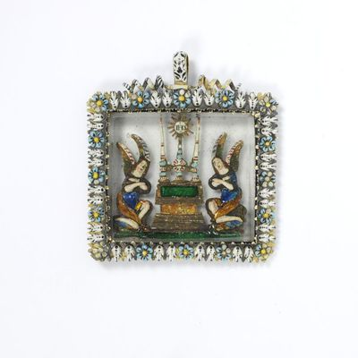 Enamelled gold pendant with a relief of angels adoring a monstrance set under glass, made in France, about 1650.Enamelled gold pendant with a relief of angels adoring a monstrance (a sacred vessel in which the consecrated host is displayed) set under glass.Enamelled gold, glass.