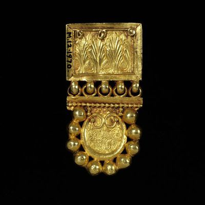 Belt end with leopards flanking a chalice, Byzantine Empire, 400-600, gold embossed and chased. Said to have been found in Malaga. Gold belt end with leopards flanking a chalice.  Gold.