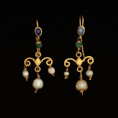 Pair of gold earrings set with sapphires and hung with emeralds and pearls, Europe (Roman), 1st-4th century.Pair of earrings of gold set with sapphires and hung with emeralds and pearls.Gold, set with sapphires and hung with emeralds and pearls.