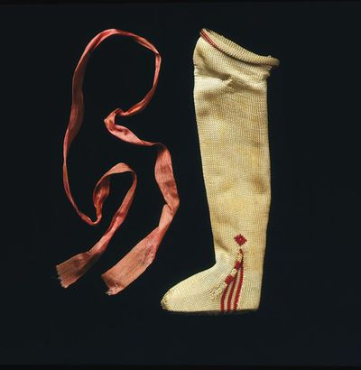Pair of doll's stockings of hand-knitted silk, London, 1690-1700.