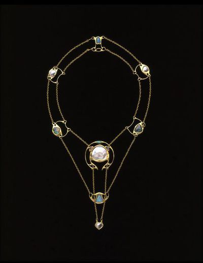 Silver and enamel necklace set with pearls, designed by Archibald Knox, made W.H. Haseler, Birmingham about 1902. A gold necklace consisting of eight delicate plaques of Celtic inspiration, each set with either an opal or blister pearl and connected by two strands of fine gold chain.  Gold set with pearl and opal.