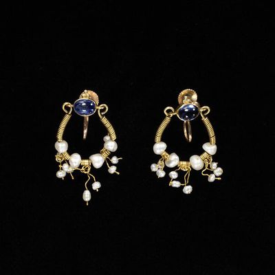 Gold earrings set with sapphires and pearls, England, about 1901.Pair of gold earrings set with sapphires and pearls.Gold, sapphires and pearls.