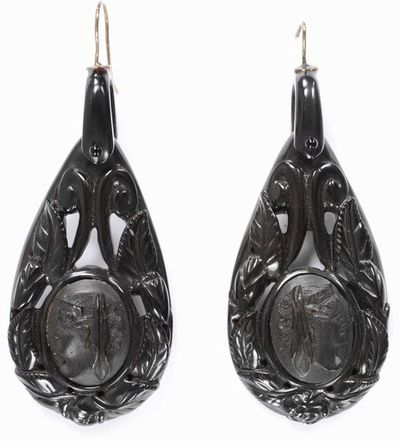 Pair of jet earrings, decorated with female head medallions symbolising 'Night', surrounded by roses and leaves. England (probably North Yorkshire), about 1870.Pair of jet earrings, decorated with female head medallions in the centre surronded by roses and leaves.Jet.