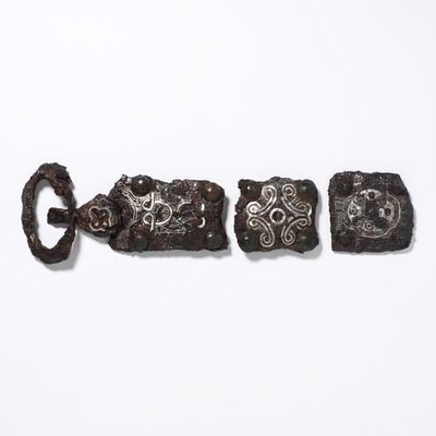 Buckle, iron with inlaid silver, probably Western Europe (Merovingian Empire), 600-50.Iron buckle with inlaid silver, and copper alloy.Iron damascened with silver, copper alloy.