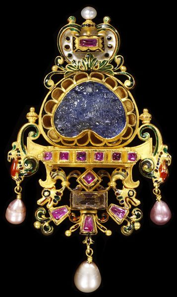 Dogali pendant brooch, enamelled gold and a large sapphire intaglio of a battle scene, probably made by Augusto Castellani, 1887-1888, Italy. Jewelled pendant brooch with enamelled gold set with rubies, a pearl, a bevelled diamond and a large sapphire intaglio of a battle scene. Hung with pearls. Applied plaque with the Castellani monogram.  Enamelled gold with pearls, daimond, ruby and a sapphire intaglio.