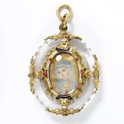 Rock crystal pendant mounted in enamelled gold, enclosing a miniature on vellum of the head and shoulders of the Virgin Mary, with relics of St. Tranquil set in the back, Spain, ca.1600.Rock crystal pendant mounted in enamelled gold, enclosing a miniature on vellum of the head and shoulders of the Virgin Mary, with relics of St. Tranquil set in the back.Rock crystal mounted in enamelled gold, enclosing a miniature on vellum.