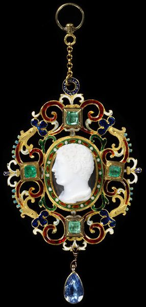 Pendant with a layered agate cameo depicting the head of Hercules, set in enamelled gold with Columbian emeralds and a sapphire, made in England, ca. 1850, the cameo ca. 1800-1810.Pendant with an earlier layered agate cameo depicting the head of Hercules, set in enamelled gold with a sapphire and Columbian emeralds.Layered agate cameo set in enamelled gold with a sapphire and Columbian emeralds.