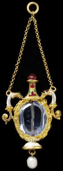 Enamelled gold pendant in the form of a flask, set with a sapphire and hung with a pearl, West European, mid 16th century.Enamelled gold pendant in the form of a flask, set with a sapphire and hung with a pearl.Gold set with a sapphire and hung with a pearl.