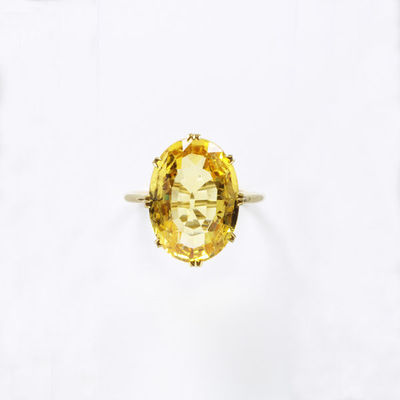 Ring, yellow faceted oval sapphire set in a gold coronet mount, made in Europe, 1800-1869.Ring with a yellow faceted oval sapphire set in a gold coronet mount.Yellow faceted oval sapphire, set in gold.
