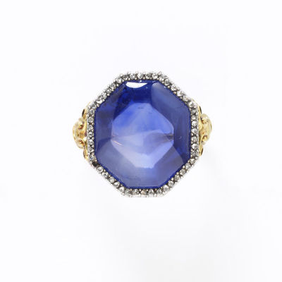 Ring, star sapphire with a border of rose-cut diamonds in a gold setting of about 1830, made in Europe.Star sapphire with a border of rose-cut diamonds in a gold ring.Star sapphire set in gold with rose-cut diamonds.