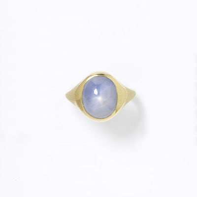 Ring, pale grey blue star sapphire cut as an oval cabochon and set in a gold mount, made in Europe, 1800-1869.Ring with a pale grey blue star sapphire cut as an oval cabochon and set in a gold mount.Cabochon star sapphire set in gold.