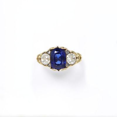 Ring, deep blue oblong sapphire flanked by two brilliant-cut diamonds in a gold setting of about 1830, made in Europe.Ring with a deep blue oblong sapphire flanked by two brilliant-cut diamonds in a gold setting.Sapphire with brilliant-cut diamonds in a gold setting.