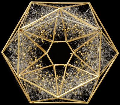 Hexagonal brooch of gold and platinum, its geometric framework containing a swirling mass of fine platinum wire decorated with granules of gold.  Gold and platinum wire.