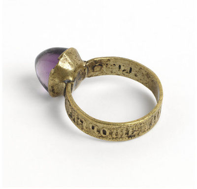 Latten (copper alloy) ring, the projecting bezel re-set with an amethyst, the shoulders stamped with roses. The hoop inscribed in black letters ''par / grant / amour'', west Europe, ca.1400.Copper alloy ring, the projecting bezel now set with an amethyst, the shoulders stamped with roses. The hoop inscribed in black letter 'par / grant / amour''.Copper alloy, stamped and engraved; amethyst.
