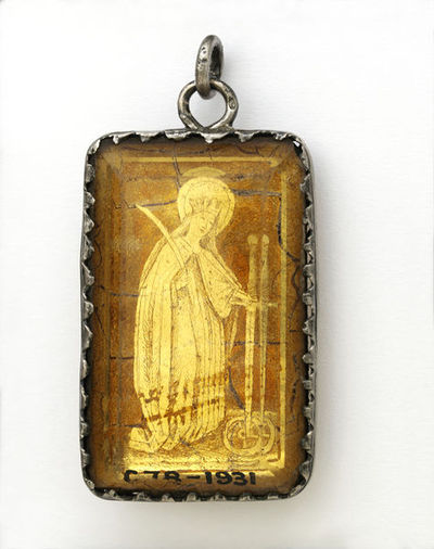 Rectangular pendant, two back-to-back bevelled edge rock crystal panels each backed with engraved gold leaf depicting St. Catherine of Alexandria and St. Christopher, mounted in a silver frame, probably Upper Rhenish, about 1470-1480.Rectangular pendant consisting of two panels of rock crystal back-to-back, each panel with bevelled edge and backed with engraved gold leaf. The panels are held together with a silver mount or frame with wavy edge and small fixed hook at the top through which passes a single link. One engraved image is of St. Catherine who stands in long robe and cloak, turned slightly to her left. She wears a crown over her long loose hair behind which is a halo. In her right hand she holds a palm and in her left a large sword which she points downwards at a wheel lying flat on the ground. The other engraved image is of St. Christopher who wears a large cloak and long robe and has a beard and long hair. Holding a staff in the form of a branch with leaves at the top, he wades across a river bearing the Christ Child with halo on his shoulders.Engraved gold leaf behind rock crystal, in a silver mount.