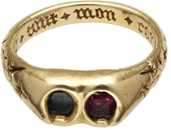 Gold finger ring set with a sapphire and a garnet, engraved flowers and inscription on the hoop.Gold finger ring, set with a sapphire and a garnet. The wide shoulders are engraved with foliate motifs, and terminate in a broad bezel with a double setting, containing a sapphire and a garnet. Underneath this bezel is a compartment covered by a sliding panel. Inscribed inside the hoop, an inscription in Gothic script.Gold ring set with a sapphire and a garnet; engraved flowers and inscription on the hoop.