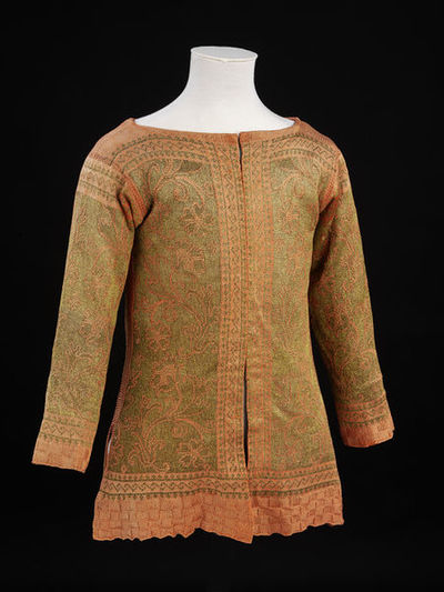 A waistcoat knit of coral pink and silver-gilt silk, 1630-1700, Italian.