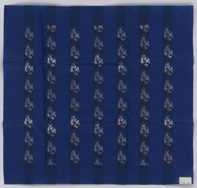 Headtie with blue ground with rows of fairy tale castles in black and mauve silk and silver metallic thread; Switzerland, 1982-1983.