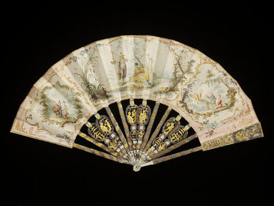 Folding fan, leaf of vellum painted in watercolours with carved mother-of-pearl sticks, leaf design after Jean-Baptiste Pillement, France, 1760-70.Fan leaf of vellum painted in watercolours. Three vignettes make up the design, showing Chinese fishermen, Chinese children playing on a see-saw, and Chinese children making music. Each scene is set in a landscape framed by delicate rococo scrolls. The reverse is painted with a spray of pink flowers outlined with gilt. The sticks are of carved and pierced mother-of-pearl showing Chinoiserie scenes, inlaid with gilt and silver foil. The sticks that support the leaf are made from wood laminated on to the mother-of-pearl sticks. Pin of white paste.Painted in watercolour on vellum, with carved mother-of-pearl sticks and guards, decorated with gilt and silver foil.