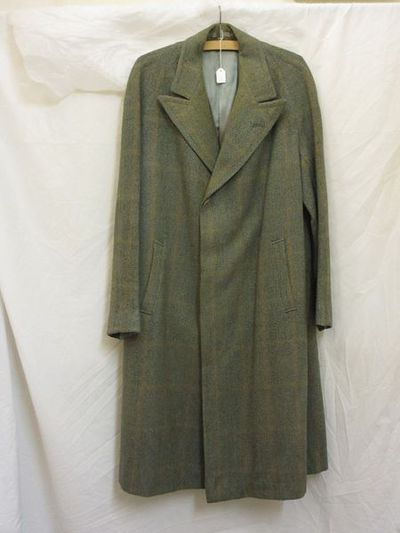 Man's coat, green check tweed with raglan sleeves, probably British, 1938-1940. Man's coat of green check tweed with raglan sleeves. Wool tweed.