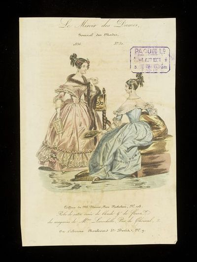 Two afternoon or dinner dresses by Mme Larochelle, Paris. Hand-coloured engraving from Le Miroir des Dames, 1836. Two dresses for dinner or formal day wear, one pink with lace flounce and flower trimming and a brown fur boa; the other blue with lace trimming and flowers. Front and back views of a hairstyle with curls and flowers.  Shown in an interior with an ottoman and a high backed chair with twisted wooden supports.