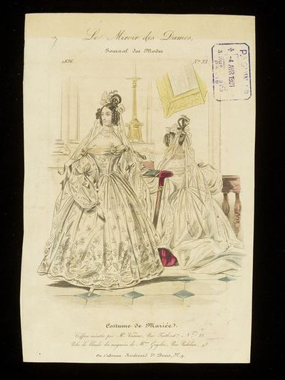 Front and back views of a wedding dress and veil by Mme Gagelin, with hairstyle by M. Vasseur. Hand-coloured engraving from Le Miroir des Dames, 1836. Front and back views of a wedding dress with large sleeves and low cut neckline, the shoulders covered with an embroidered muslin tucker tucked into the neckline. Shown in an ecclesiastical interior, the woman shown from the back kneeling before an altar on which part of a gold candlestick can be seen along with the frame of a picture which faintly shows a kneeling woman reading a Bible (possibly the Annunciation)