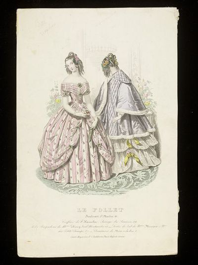 Two women's evening dresses, one a Robe Pompadour by Mme Thierry, Paris, the other by Mme Mercier. Hairstyles by F. Hamelin. Hand-coloured engraving from Le Follet. Paris, mid-1840s. Two women in evening dress in an interior. On the left, a pink and white striped silk dress called a Robe Pompadour, with looped up overskirt and pleated bodice and sleeves, on the right, a pale grey quilted mantle edged with white fur over a flounced white lace dress with yellow ribbons and flowers. They stand beside flower troughs with a mirror behind them, in which is faintly reflected a chandelier.