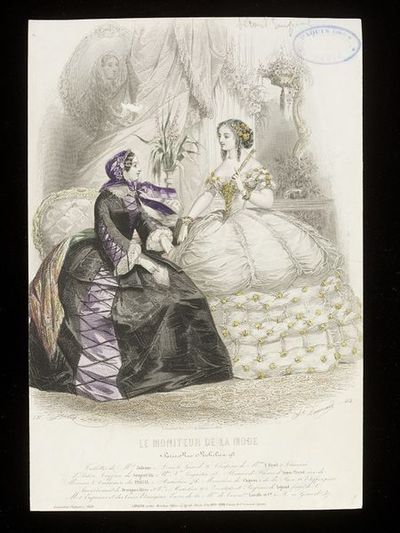 Jules David and Bonnard. Day dress and ball gown by Mme Judenne, Paris, bonnet by Mme E. Bayol. Hairstyle by Sergent Fils. Shawl from Persan.  Hand-coloured engraving from Le Moniteur de la Mode, Paris, late 1850s. Two women in an interior. On the left, seated woman in a black moiré day dress with lilac gores overlaid with lacing, with a violet satin bonnet and a shawl. On the right, standing woman with an elaborate hairstyle, in an extravagant white ballgown with puffed fabric and frills, hair and dress lavishly trimmed with yellow flowers.  In the background, an elaborate curtain, a console table with a pier glass above it, a framed portrait of a woman, and an armchair, with a vase of flowers (foxgloves) in the background, a garland of roses wound around a pillar, and a hanging-basket of flowers.