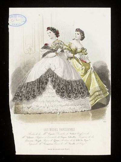 François-Claudins Compte-Calix. Two evening gowns by Mme Fauvet with hairstyles by M. Tilman. Les Modes Parisiennes, c.1860. Two women in evening gowns. In the foreground, a white dress with ruched and puffed underskirt, the overskirt and bodice trimmed with deep frills of black lace, neckline and hair also trimmed with deep red roses and black lace. On the right, a golden-yellow satin evening dress with fluted bands at the hem.