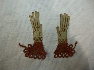 Pair of toy gloves of plaited silk and metal thread sewn and embroidered, made by Martha Edlin, England, ca. 1670.  Plaited silk and metal thread sewn and embroidered;;
