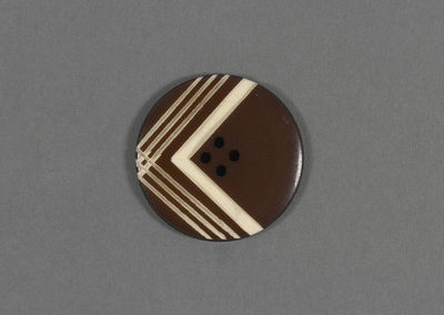 Circular button with incised chevron, plastic, possibly made in France, 1928-1939.Plastic