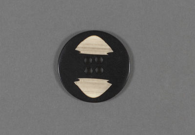 Incised composition button, made in Europe, ca. 1930.Incised, composition